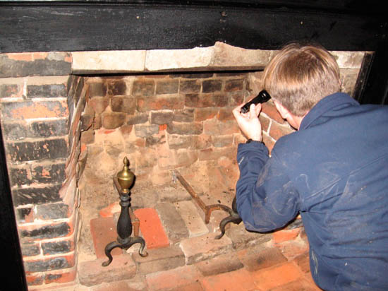 Archeological examination of historic fireplace